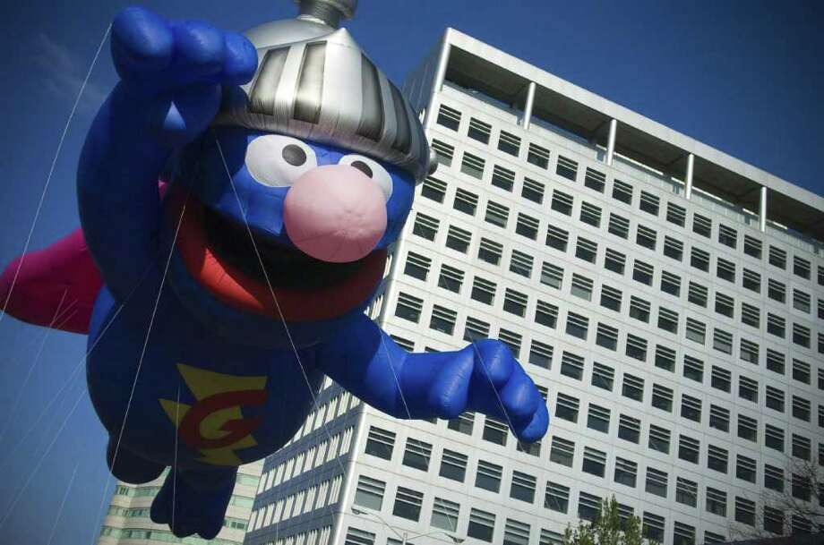 Super Grover flies down Atlantic Street during last year's UBS Parade Spectacular in Stamford. This year's parade kicks off at noon, Sunday, Nov. 21. Photo: File Photo / Stamford Advocate File Photo