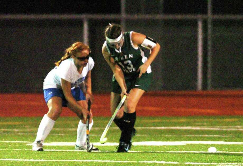 New Milford's 13, Erin Shannon competes with Glastonbury during the field hockey game at Watertown High School Nov. 16, 2010. Photo: Chris Ware / The News-Times