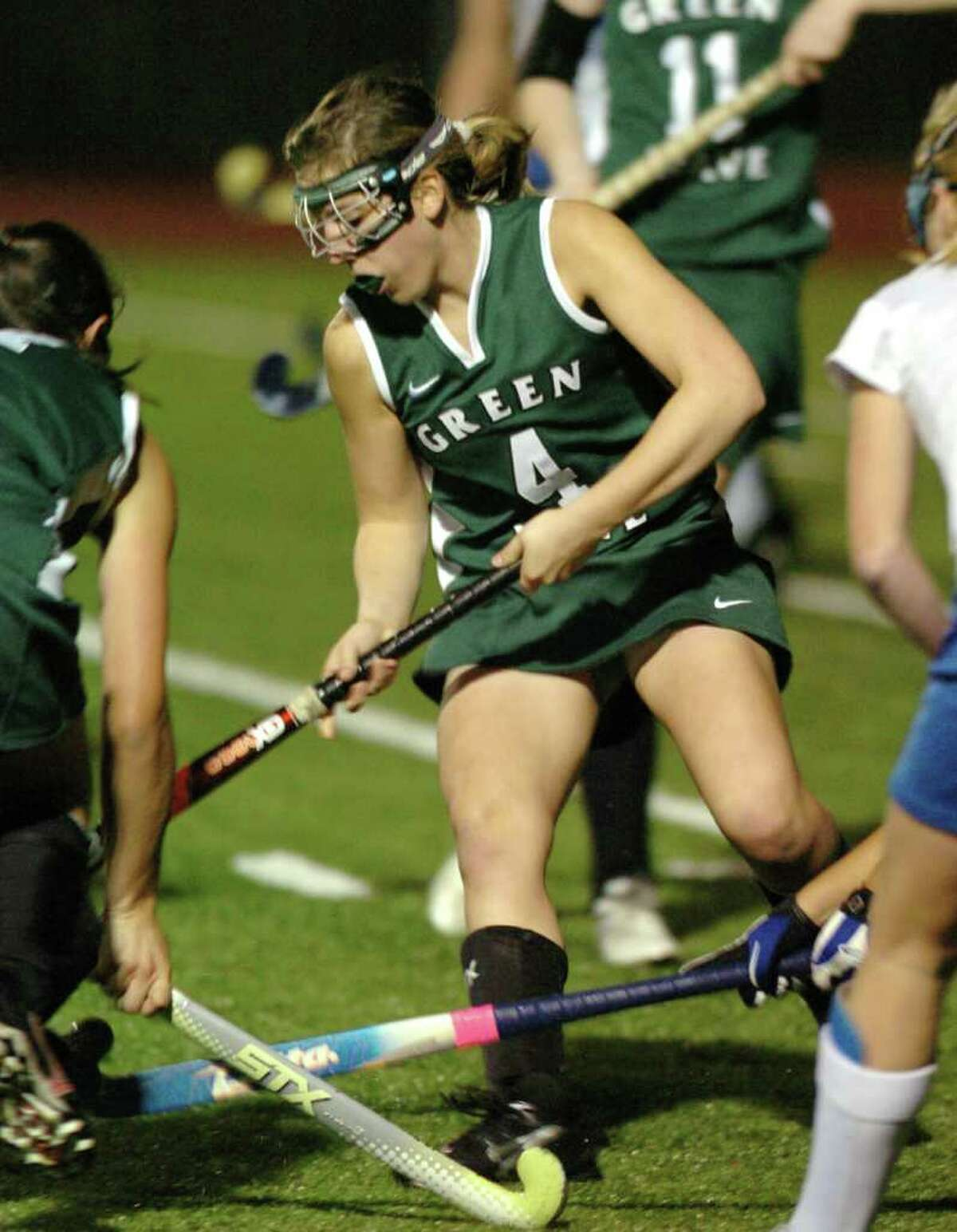 New Milford's 4, Katie Kelly competes with Glastonbury during the field hockey game at Watertown High School Nov. 16, 2010.