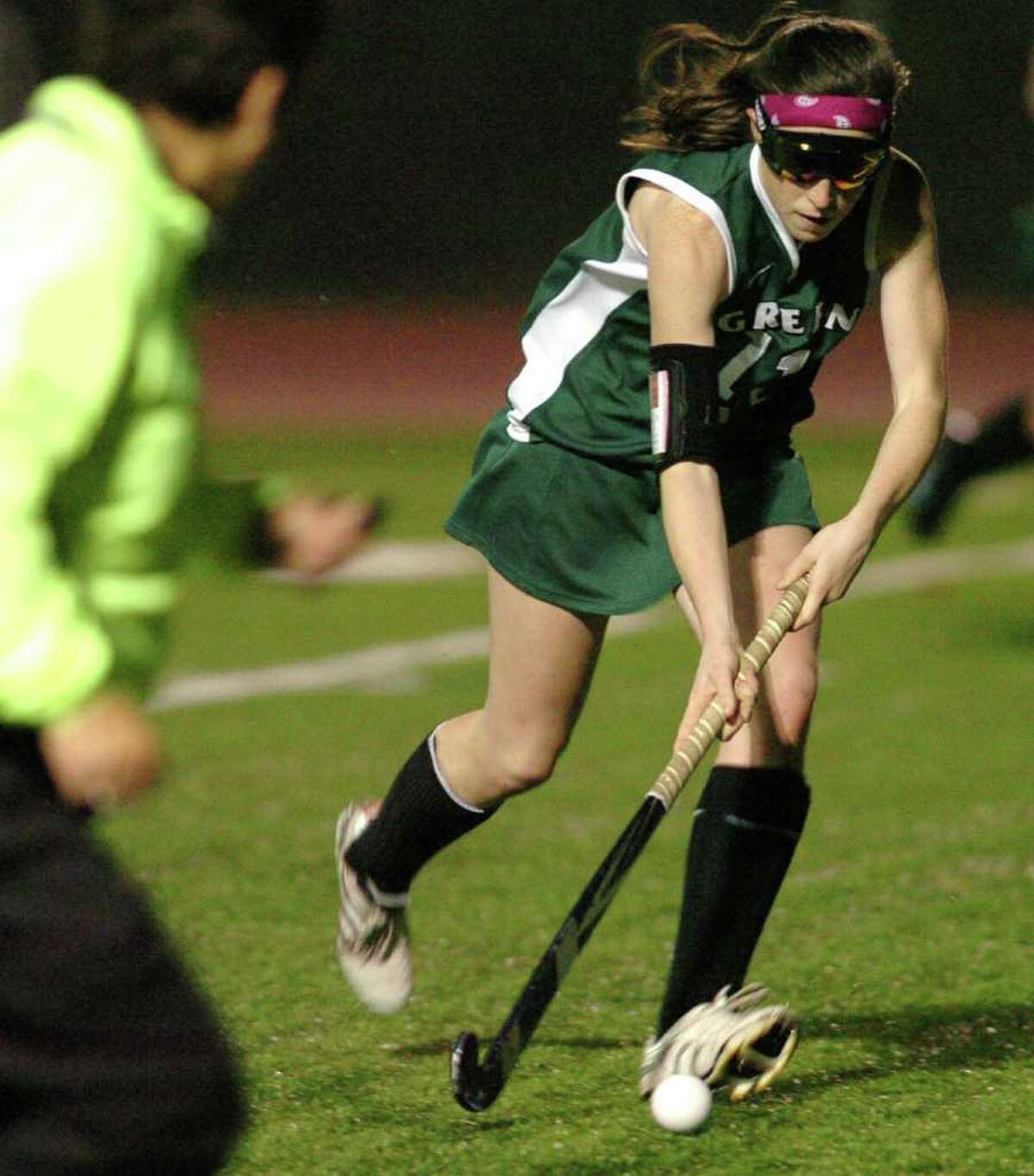New Milford's 11, Olivia Monteiro competes with Glastonbury during the field hockey game at Watertown High School Nov. 16, 2010.