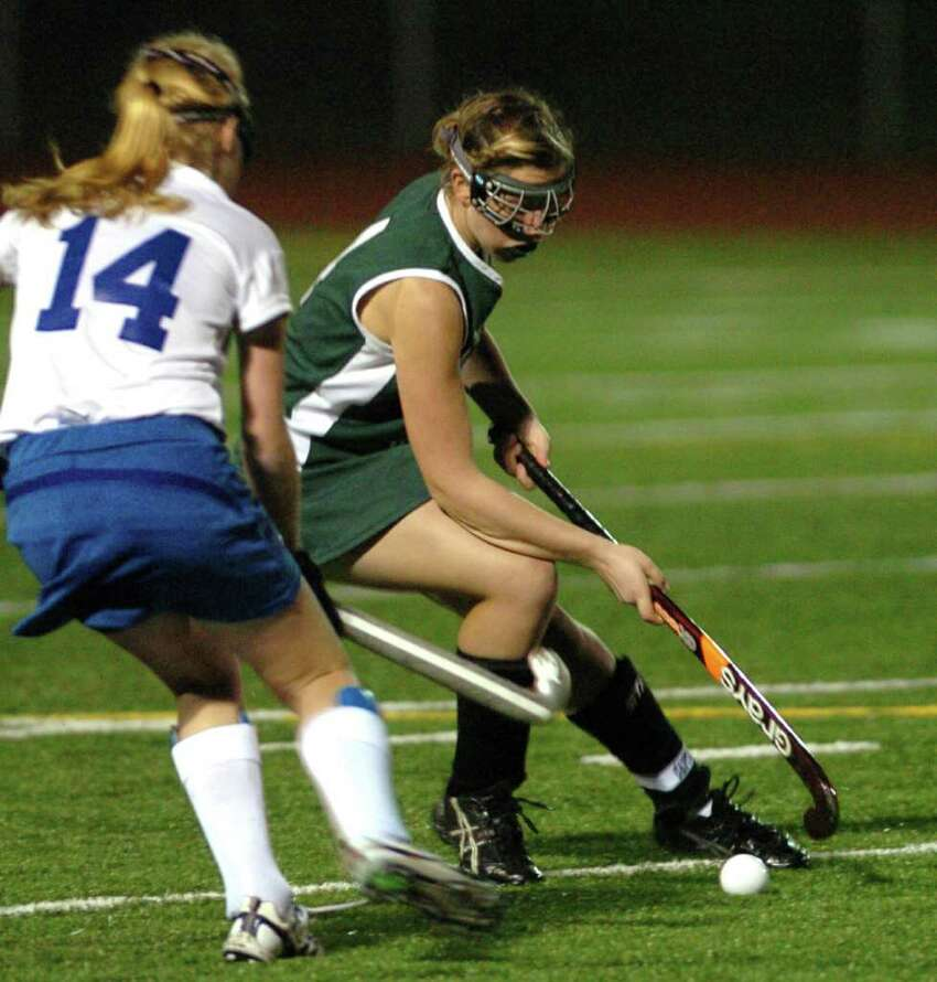 New Milford competes with Glastonbury during the field hockey game at Watertown High School Nov. 16, 2010.