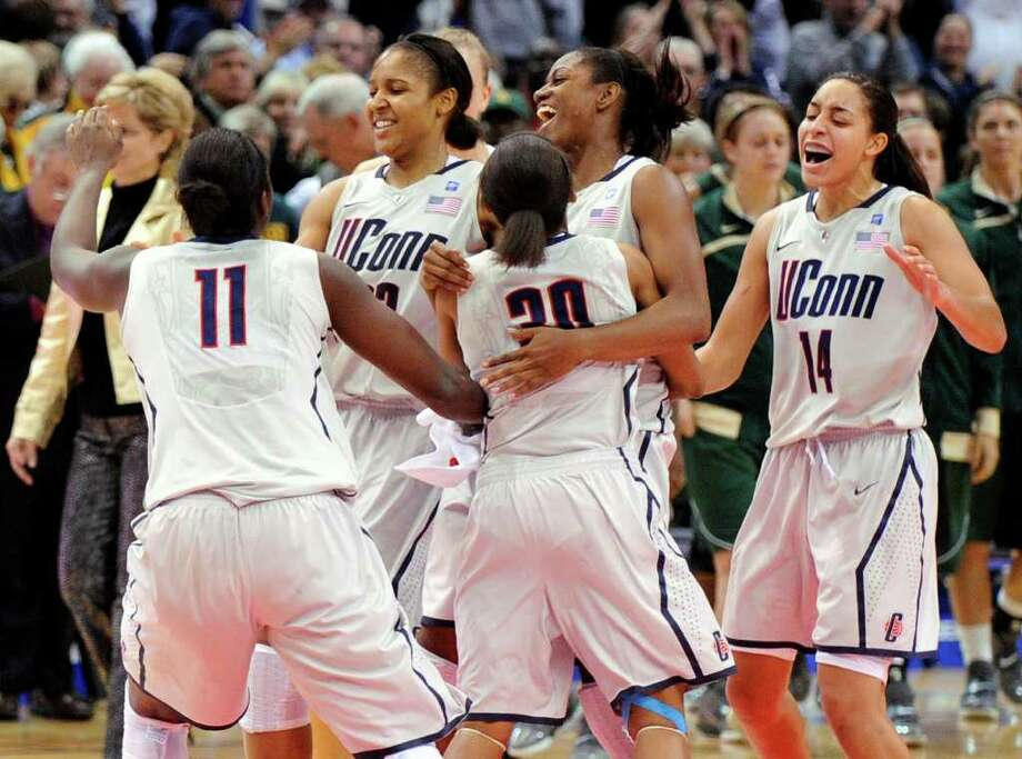 Connecticut players celebrate their 65-64 victory over Baylor in an NCAA college basketball game in Hartford, Conn., on Tuesday, Nov. 16, 2010. (AP Photo/Fred Beckham) Photo: AP