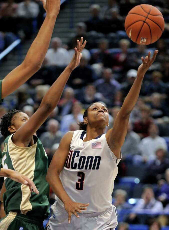 Connecticut's Tiffany Hayes, right, drives past Baylor's Shanay Washington during the first half of an NCAA college basketball game in Hartford, Conn., on Tuesday, Nov. 16, 2010. (AP Photo/Fred Beckham) Photo: AP