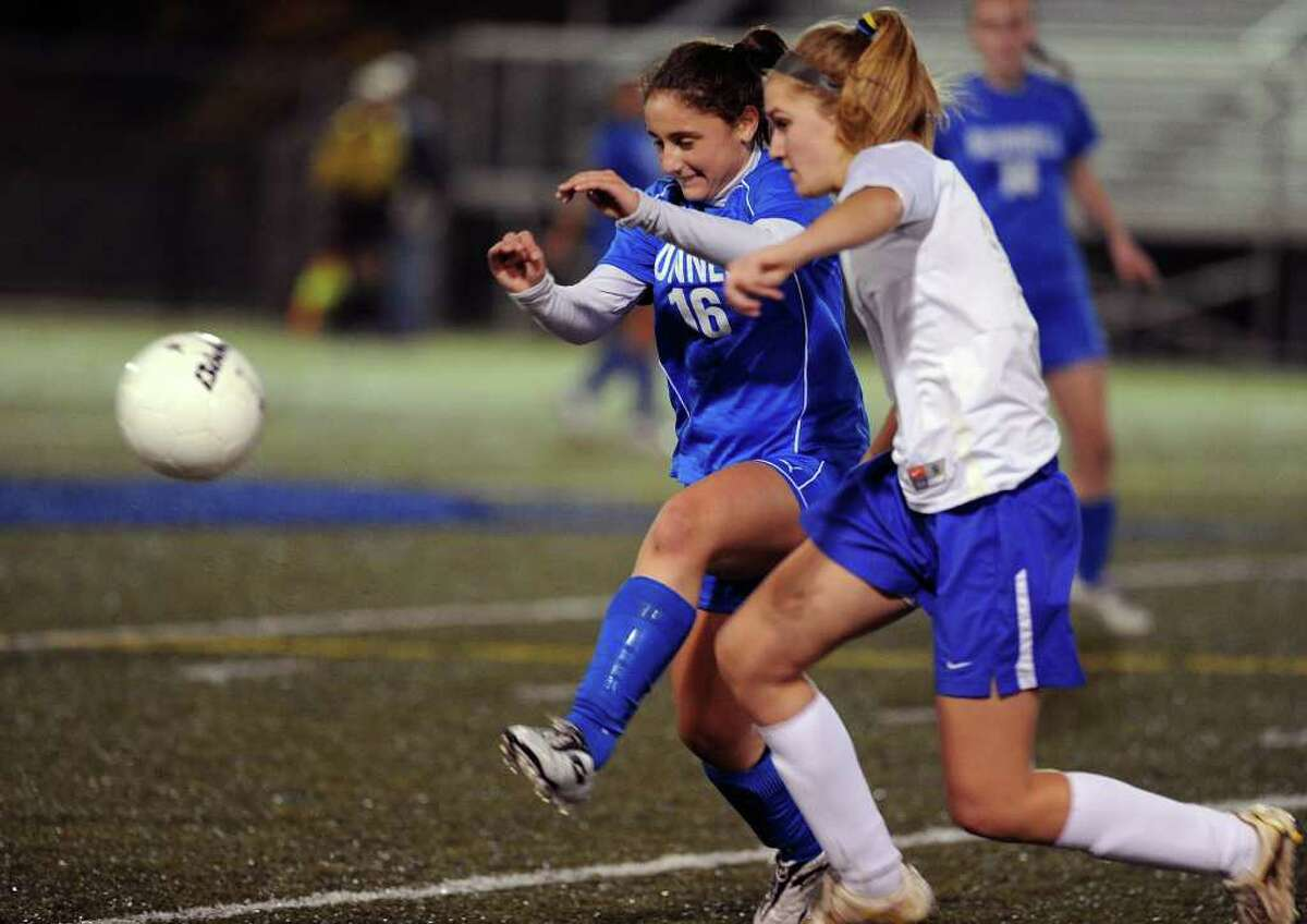 Bunnell's Kacie O'Neill kicks the ball away from an Avon defender during the State Tournament Class L Semifinal game at Municipal Stadium in Waterbury on Tuesday, November 16, 2010.