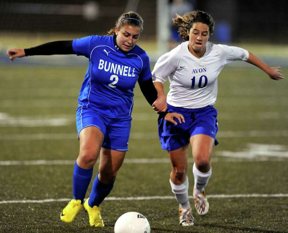 Bunnell's Lauren Thomas, left, and Avon's Katie Zabrano, right, compete for control of the ball during the State Tournament Class L Semifinal game at Municipal Stadium in Waterbury on Tuesday, November 16, 2010.