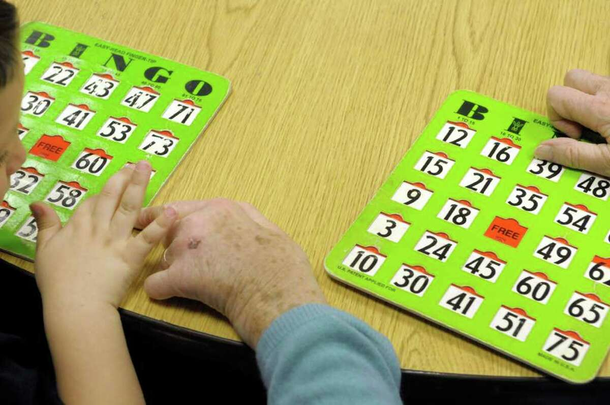Residents and kindergarten students from Miller Hill ? Sand Lake Elementary School play bingo together at the Van Rensselaer Manor Nursing Home in Troy on Tuesday. The Van Rensselaer Manor Nursing Home runs intergenerational programs for its residents two to three times a week. (Paul Buckowski / Times Union)