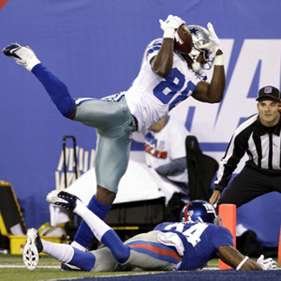 Cowboys wide receiver Dez Bryant catches a pass for a touchdown as Giants cornerback Terrell Thomas falls down on the play Nov. 14.