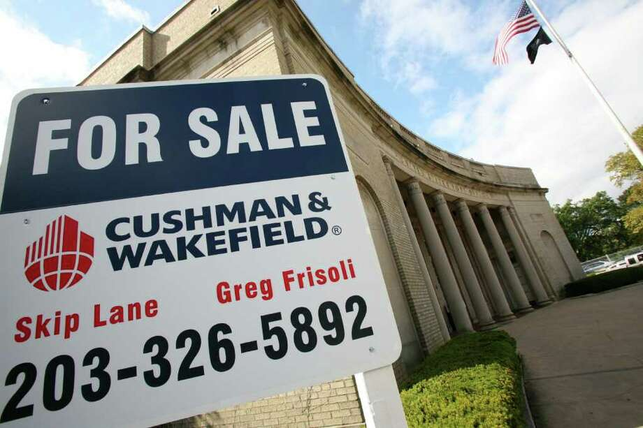 """A """"For Sale"""" sign adorns the front of the Post Office building on Greenwich Avenue. Photo: File Photo, ST / Greenwich Time File Photo"""