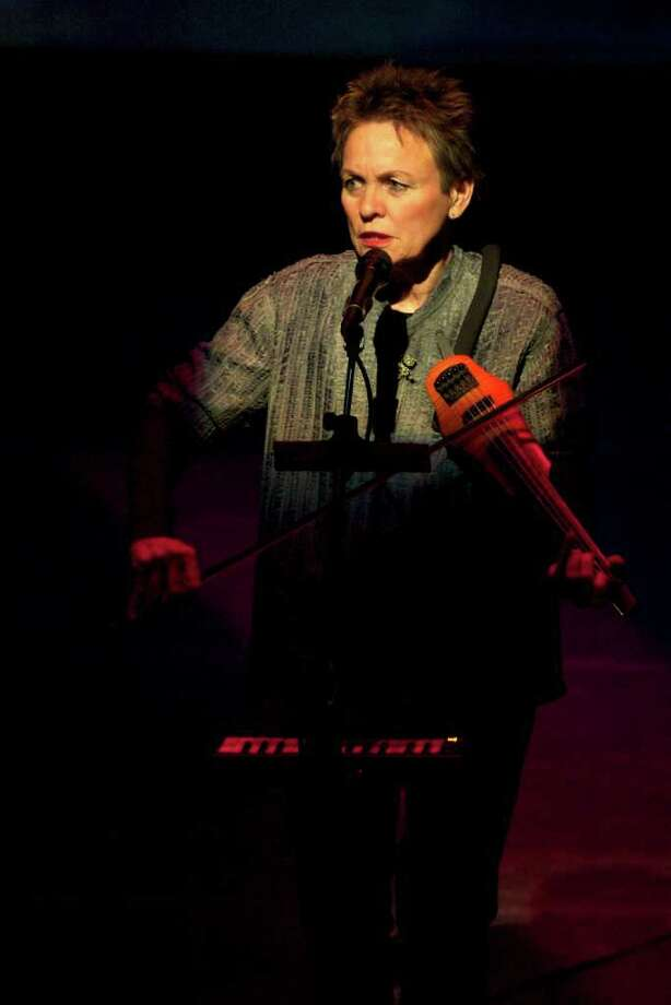 Musician Laurie Anderson performs a selection from her latest solo work ''Delusion'' at an undisclosed location on Feb. 26, 2010. (Lou Reed / Barbican Centre via Bloomberg) Photo: Lou Reed / Design Museum