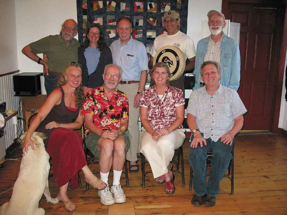 "The cast of ""The Vistors"": Top row, left to right: George Ward, Peggy Lynn, Dan Berggren, Joe Bruchac, George Wilson. Bottom row: Toby Stover, Bill Spence, Trish Miller, John Kirk (Courtesy Old Songs)"