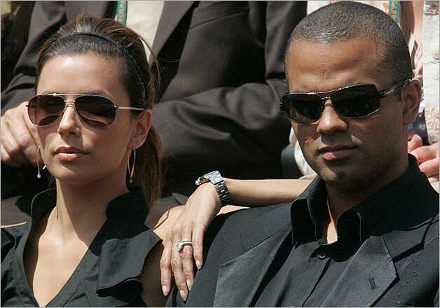 Actress Eva Longoria and Spurs guard Tony Parker watch the French Open in 2009 at the Roland Garros stadium in Paris.