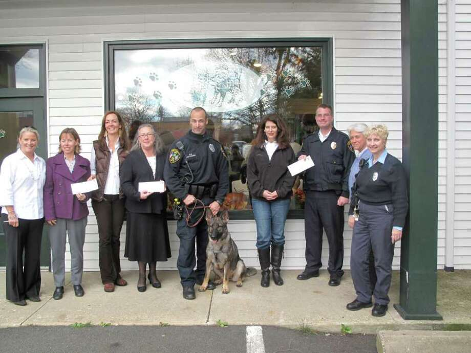The three organizations receive their checks outside of Village Critter Outfitter Photo: Contributed Photo / New Canaan News