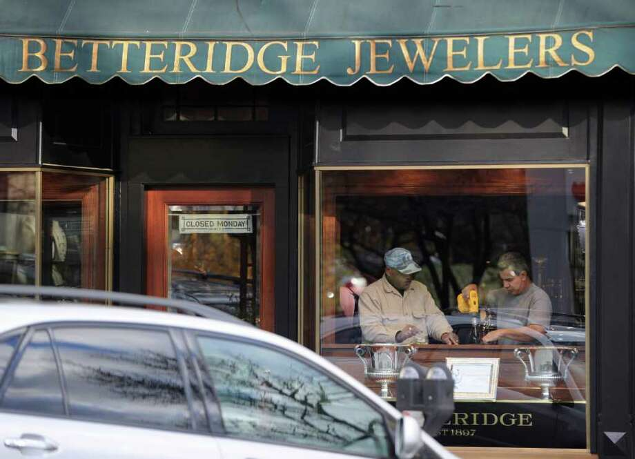 Two workmen at Betteridge Jewelers on Greenwich Avenue, Wednesday afternoon, Nov. 17, 2010. Two masked men robbed the store Tuesday morning by smashing a jewelry case with a sledgehammer and getting away with an unspecified amount of jewelry, police said. Photo: Bob Luckey / Greenwich Time