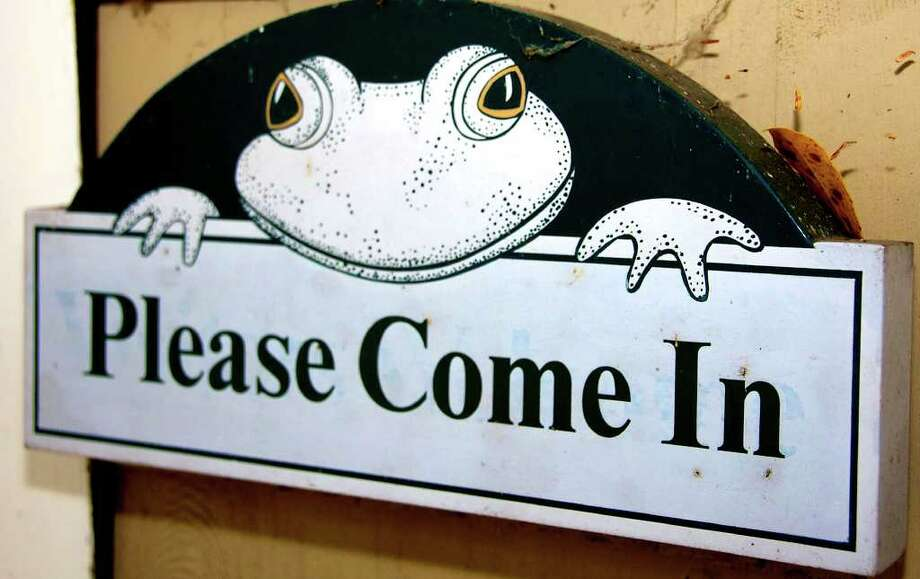 "SPECTRUM/The Pratt Nature Center in New Milford hosts area children for its ""Science and Nature Explorers"" program. The center's logo frog welcomes visitors. November 2010. Photo: Trish Haldin / The News-Times Freelance"