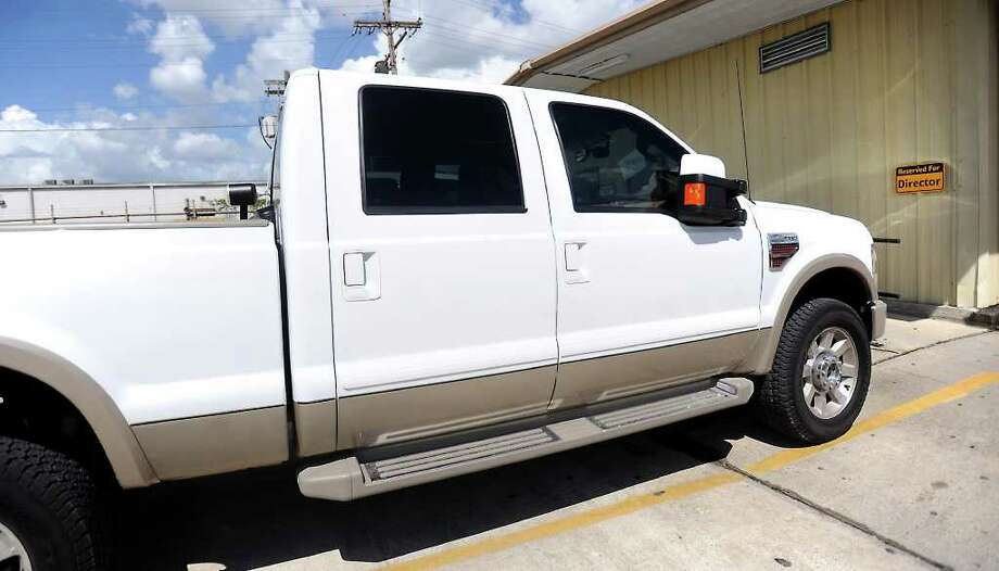 Two trucks from the Beaumont ISD Transportation Department have been seized by the constable's office to be auctioned off to pay for attorney fees from the South Park case. Tammy McKinley/The Enterprise Photo: TAMMY MCKINLEY / Beaumont