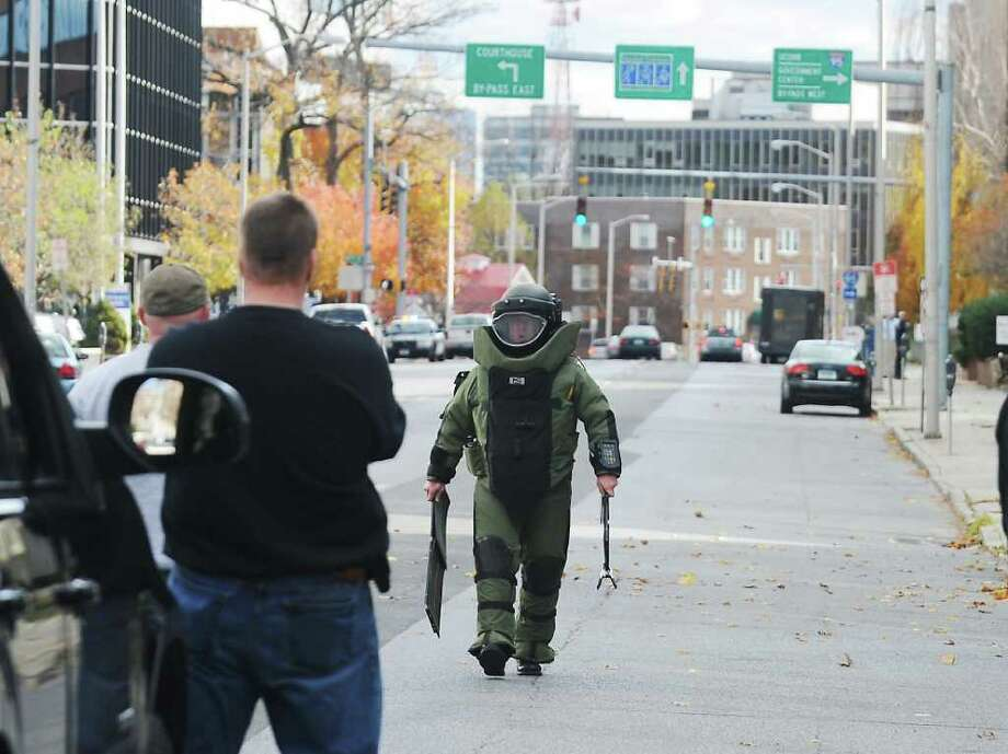 The bomb squad from the Stamford Police Department and emergency officials investigate a suspicious package left on Summer Street in Stamford, Conn. on Wednesday November 17, 2010 Photo: Kathleen O'Rourke / Stamford Advocate
