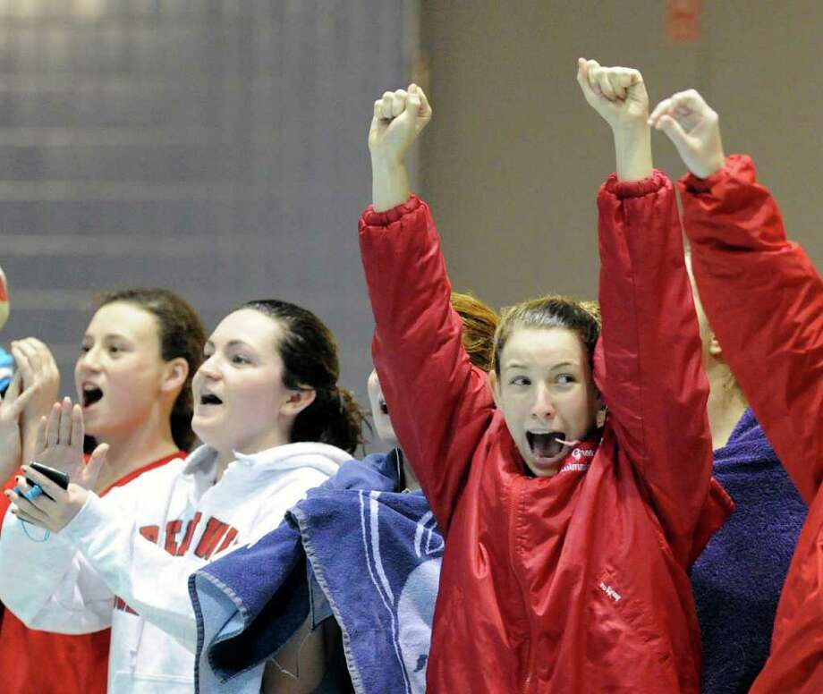 Hannah Bear of Greenwich High School, right,  cheers for her teammates during the CIAC Class LL Girls Swimming Championship Meet at Wesleyan University, Middletown, CT, Wednesday night, Nov. 17, 2010. Photo: Bob Luckey / Greenwich Time