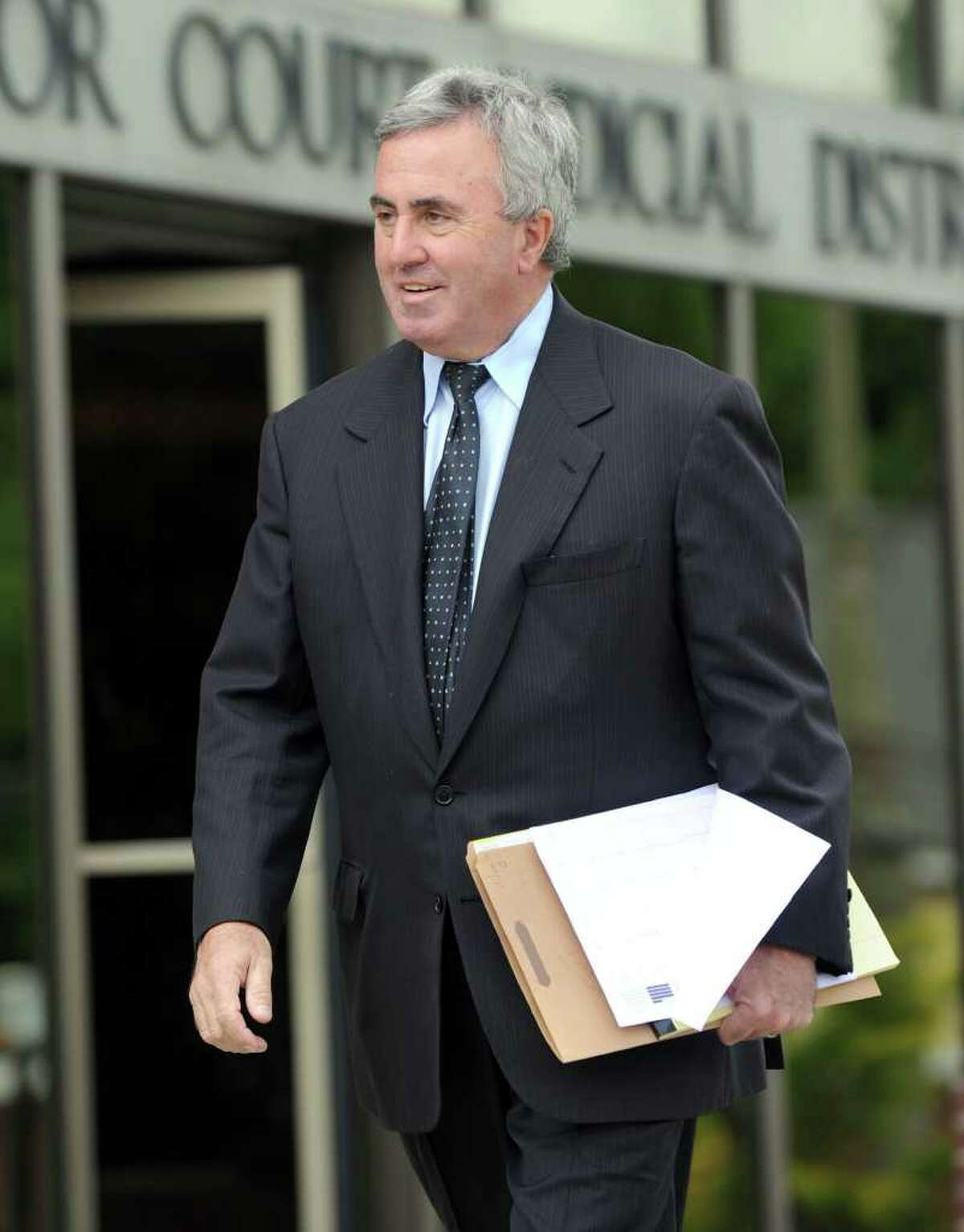 """Michael """"Mickey"""" Sherman, a Greenwich-based criminal defense lawyer leaves Danbury Superior Courtin on June 11, 2010. Sherman faces up to two years in prison as a result of his guilty pleas last summer to two misdemeanor charges of failing to pay $420,710 in owed income taxes for the years 2001 and 2002. He already repaid the taxes owed."""