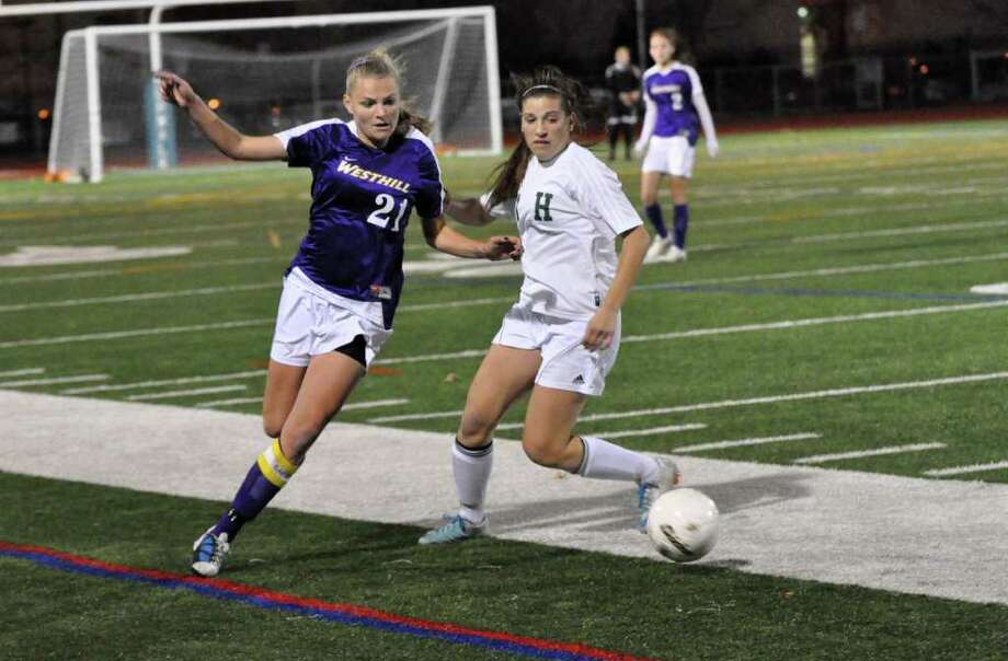 Westhill's Kristen Eriksen controls the ball as Hamden's Ashley Wendland defends during the Class LL girls soccer semifinals at Norwalk High on Wednesday, Nov. 17, 2010. Photo: Amy Mortensen / Connecticut Post Freelance