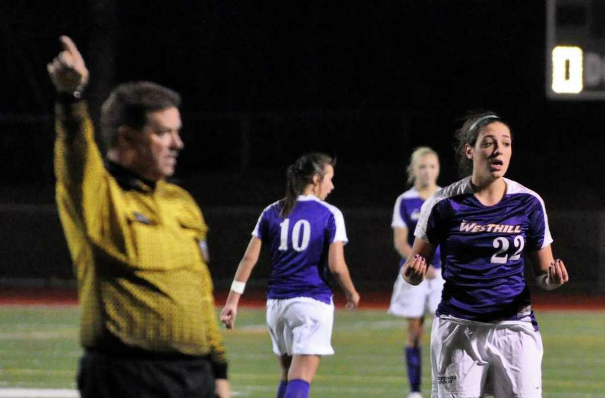 Westhill's Teressa Dunster reacts as the referee makes a call during the Class LL girls soccer semifinals against Hamden at Norwalk High on Wednesday, Nov. 17, 2010.