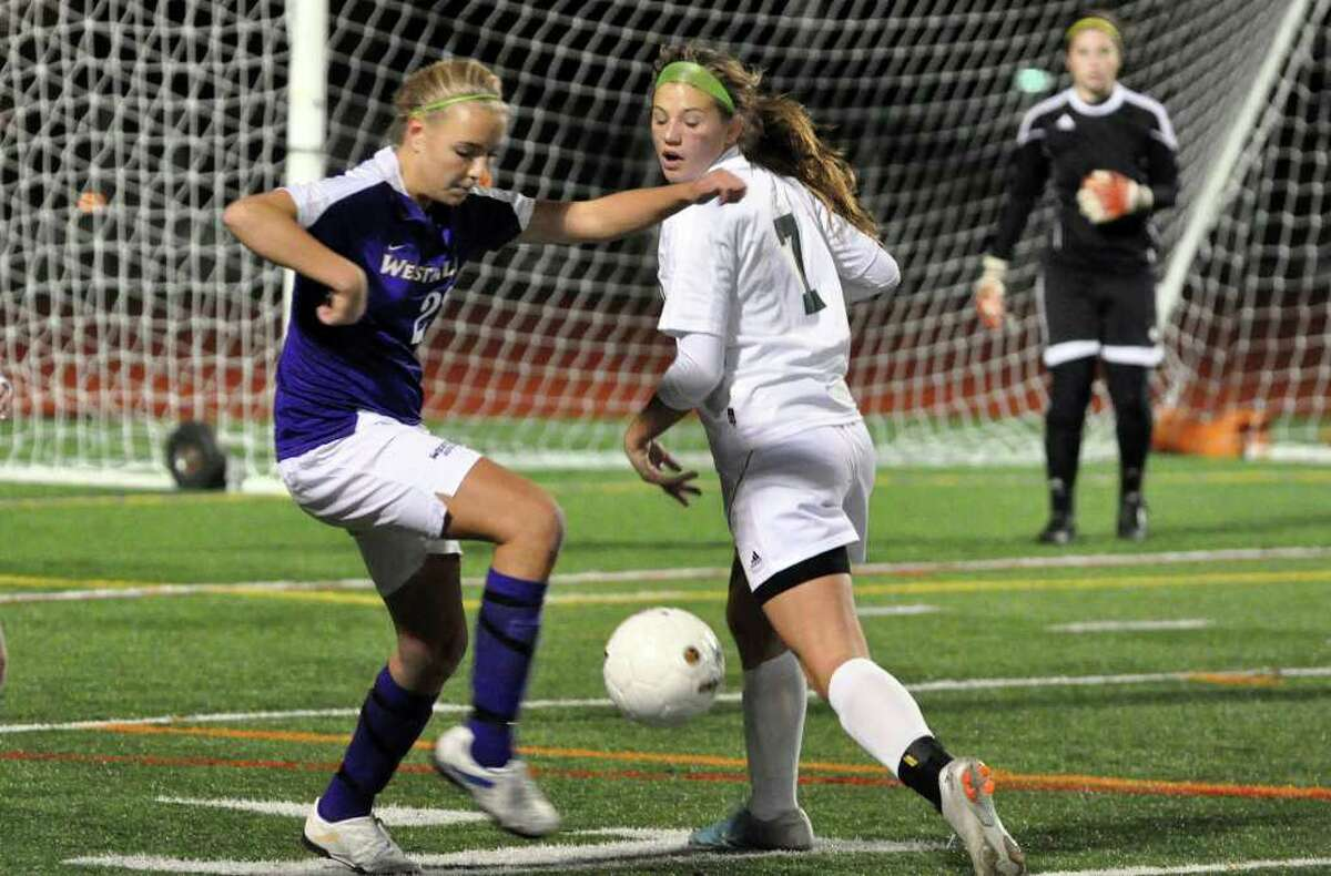 Westhill's Nicole Eriksen controls the ball as Hamden's Rachel Ugolik defends during the Class LL girls soccer semifinals at Norwalk High on Wednesday, Nov. 17, 2010.