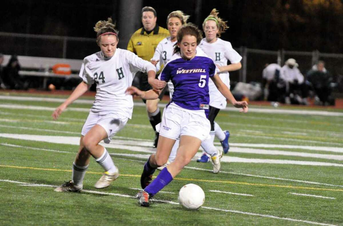 Westhill's Julia Busto controls the ball as Hamden's Rachel Zimmerman defends during the Class LL girls soccer semifinals at Norwalk High on Wednesday, Nov. 17, 2010.