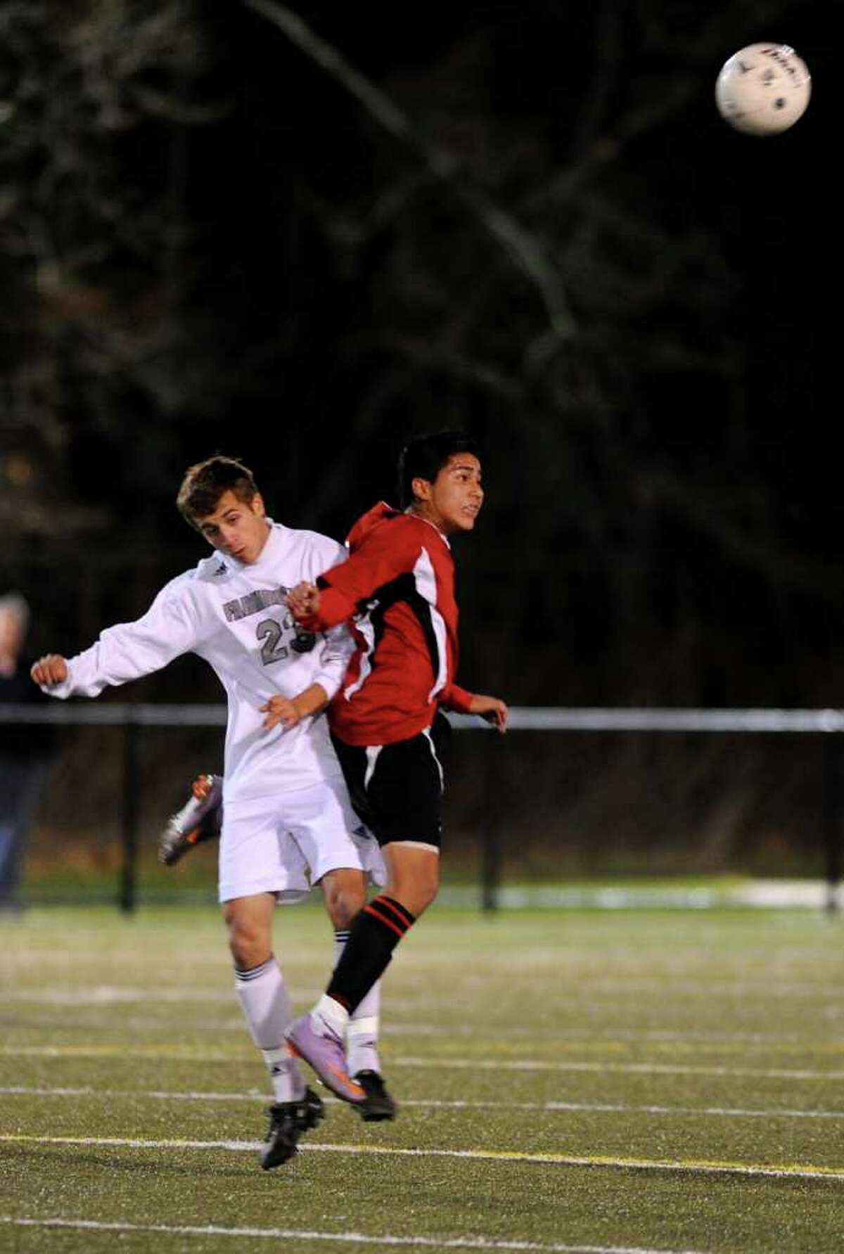 Bridgeport Central's Abelardo Mendoza, right, and Farmington's Danny Manfredi, left, jump to head the ball during the Boys Soccer State Tournament Class LL Semifinal game at Municipal Stadium in Waterbury on Wednesday, November 17, 2010.