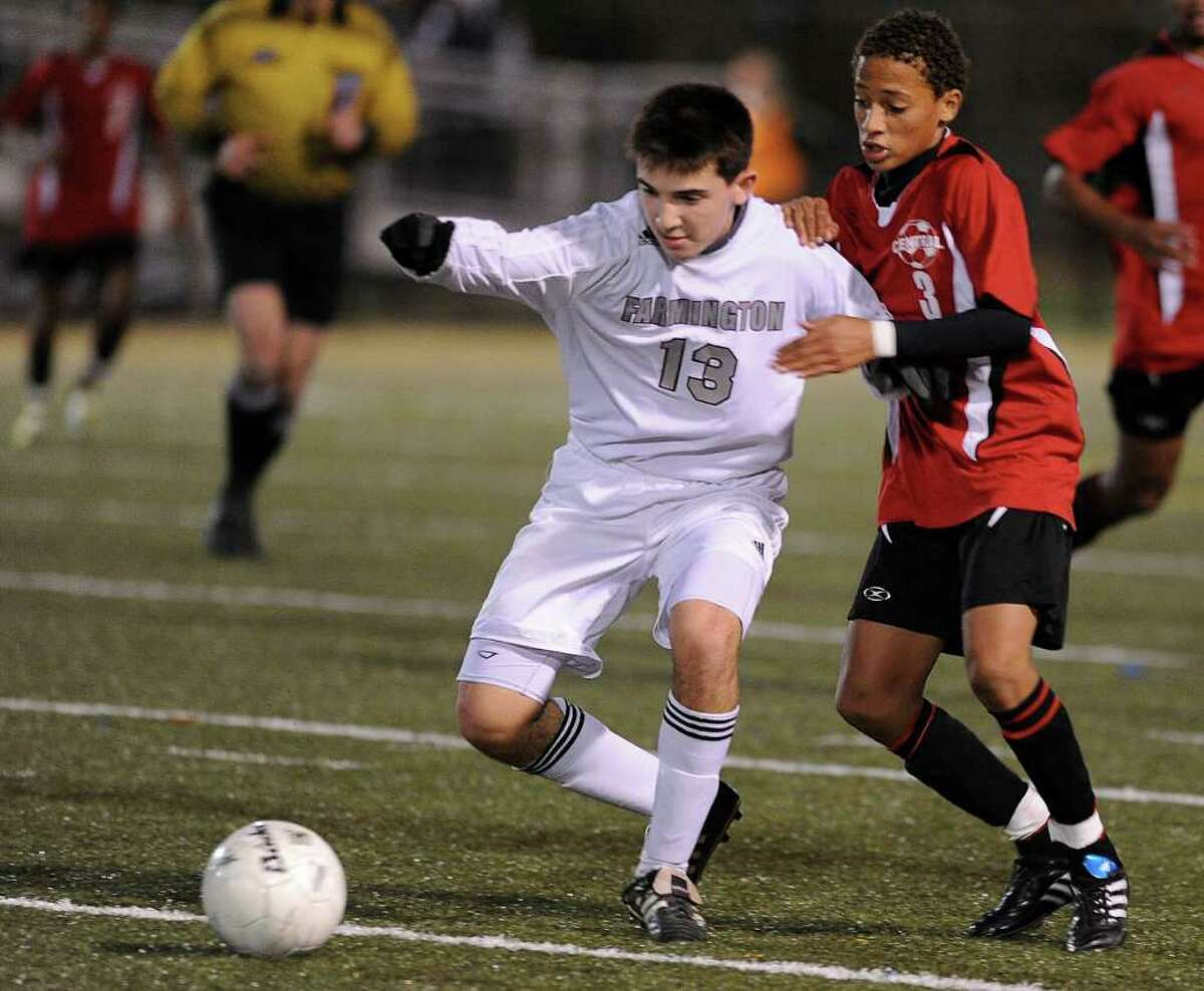 Bridgeport Central's Nelit Soares, right, and Farmington's Tyler Hoffman, left, compete for control of the ball during the Boys Soccer State Tournament Class LL Semifinal game at Municipal Stadium in Waterbury on Wednesday, November 17, 2010.