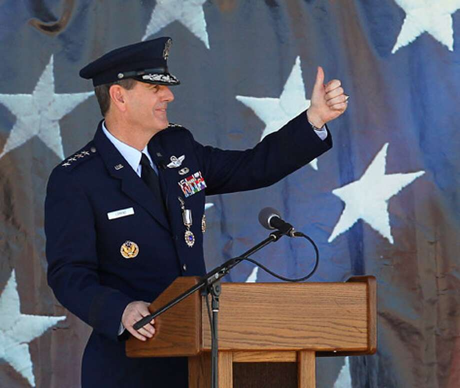 Air Force Gen. Stephen Lorenz, outgoing head of the Air Education and Training Command at Randolph AFB, offers a thumbs-up during his remarks at the change of command ceremony.