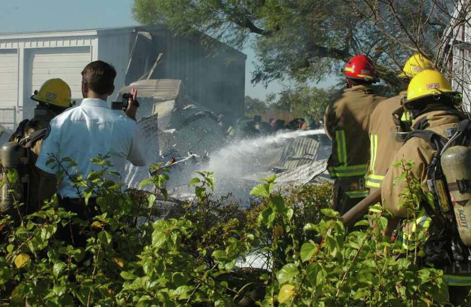 Firefighters from several volunteer fire departments battle a blaze at Al Cook Nursery and Landscaping on Texas 105 in Jefferson County Thursday morning. Pete Churton/The Enterprise Photo: Pete Churton