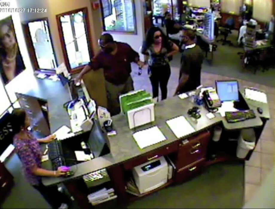 A man and a woman are suspected in the theft of 10 pairs of Gucci sunglasses in October. Photo still provided by the Beaumont Police Department