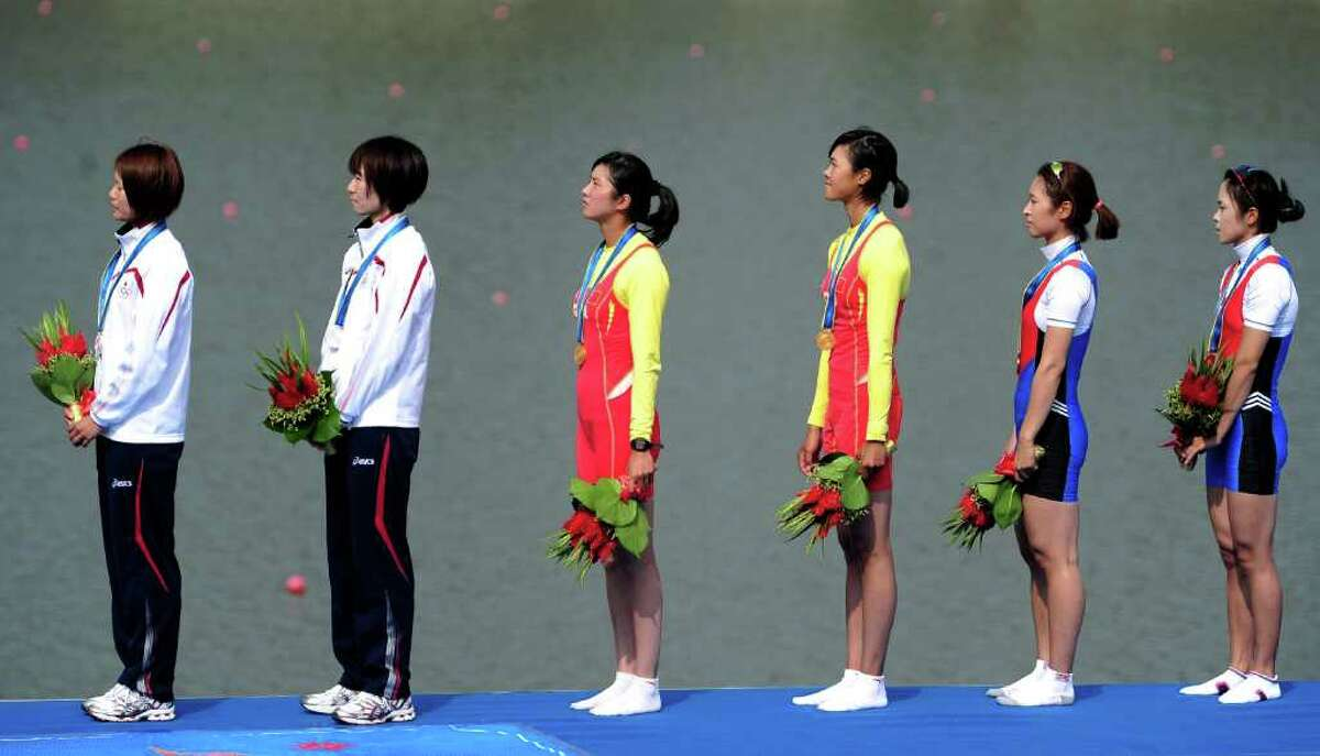 GUANGZHOU, CHINA - NOVEMBER 18: (L-R) Silver medallists Akiko Iwamoto and Atsumi Fukumoto of Japan , Gold medallists Wenyi Huang and Feihong Pan of China and Bronze medallists Myungshin Kim and Solji Kim of South Korea in the Lightweight Women's Double Sculls Final Race A during day six of the 16th Asian Games Guangzhou 2010 at International Rowing Centre on November 18, 2010 in Guangzhou, China. (Photo by Jamie McDonald/Getty Images) *** Local Caption *** Wenyi Huang;Feihong Pan;Akiko Iwamoto;Atsumi Fukumoto