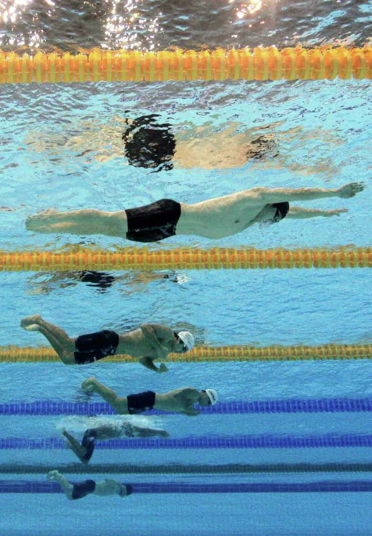 GUANGZHOU, CHINA - NOVEMBER 18: Rui Peng Xue (top) of China and Kyuwoong Choi (2nd Top) of South Korea competes in the Men's 200m Breaststroke final during day six of the 16th Asian Games Guangzhou 2010 at Aoti Aquatics Centre on November 18, 2010 in Guangzhou, China. (Photo by Adam Pretty/Getty Images) *** Local Caption *** Rui Peng Xue;Kyuwoong Choi