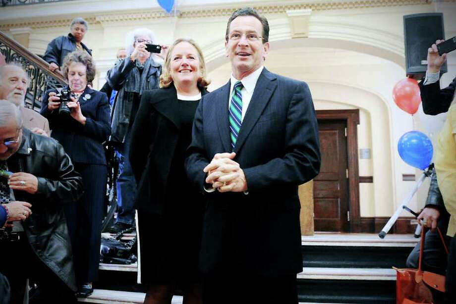 Governor-elect Dan Malloy and his wife Cathy Malloy arrive at the victory celebration at Old Town Hall in Stamford, Conn. on Wednesday November 17, 2010. Photo: Kathleen O'Rourke / Stamford Advocate