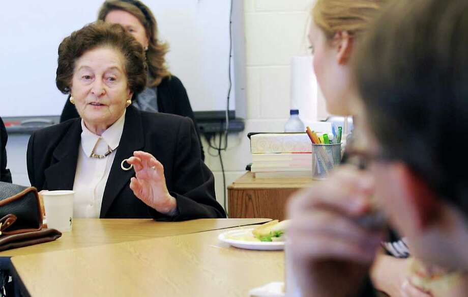 "Judith Altman, a Holocaust survivor, speaks to students during a luncheon at King in Stamford, Conn. on Thursday November 18, 2010 for ""Anne Frank Day.""   Altman, a native of Czechoslovakia, was 14 years old when her country was occupied by Germany.   She spoke to the students involved with ""The Diary of Anne Frank"" production at the school. Photo: File Photo / Stamford Advocate File Photo"
