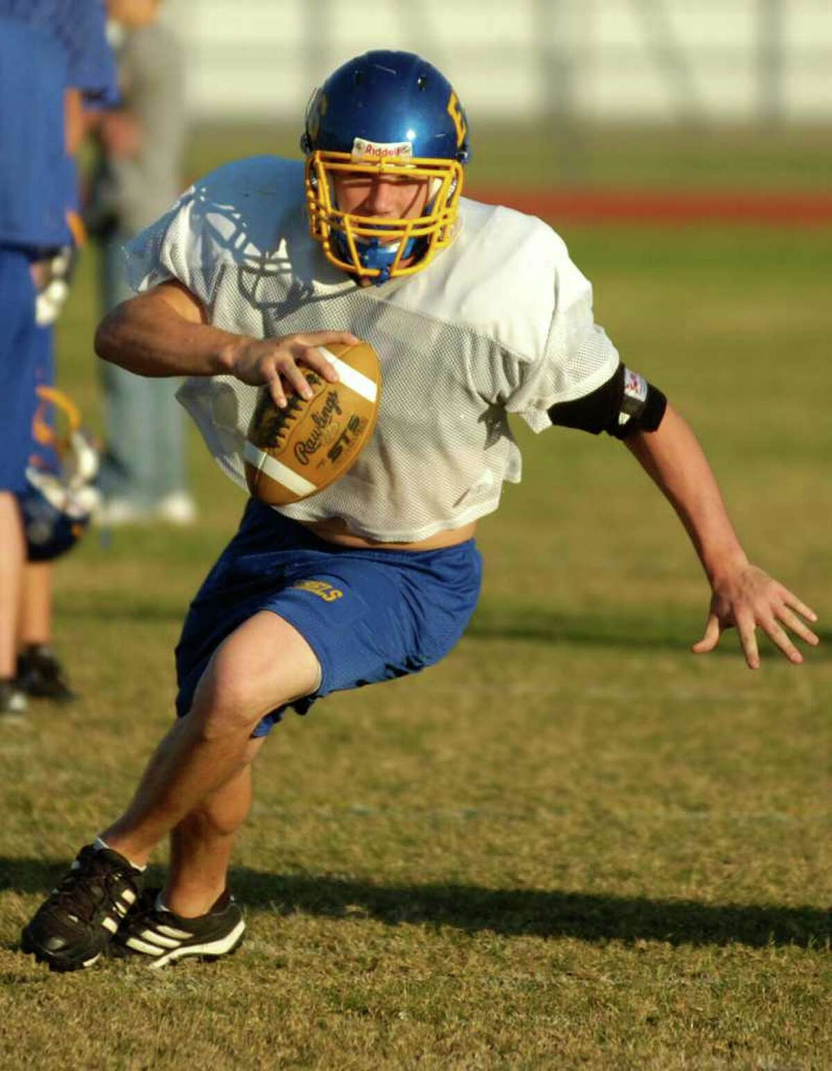 Evadale High School quarterback Billy Nichols works on a run play with his teammates on Wednesday at football practice. The Rebels travel to Rosenberg to take on D'Hanis in Class A Division II playoffs at Traylor Stadium on Friday night. November 17, 2010. Valentino Mauricio/The Enterprise