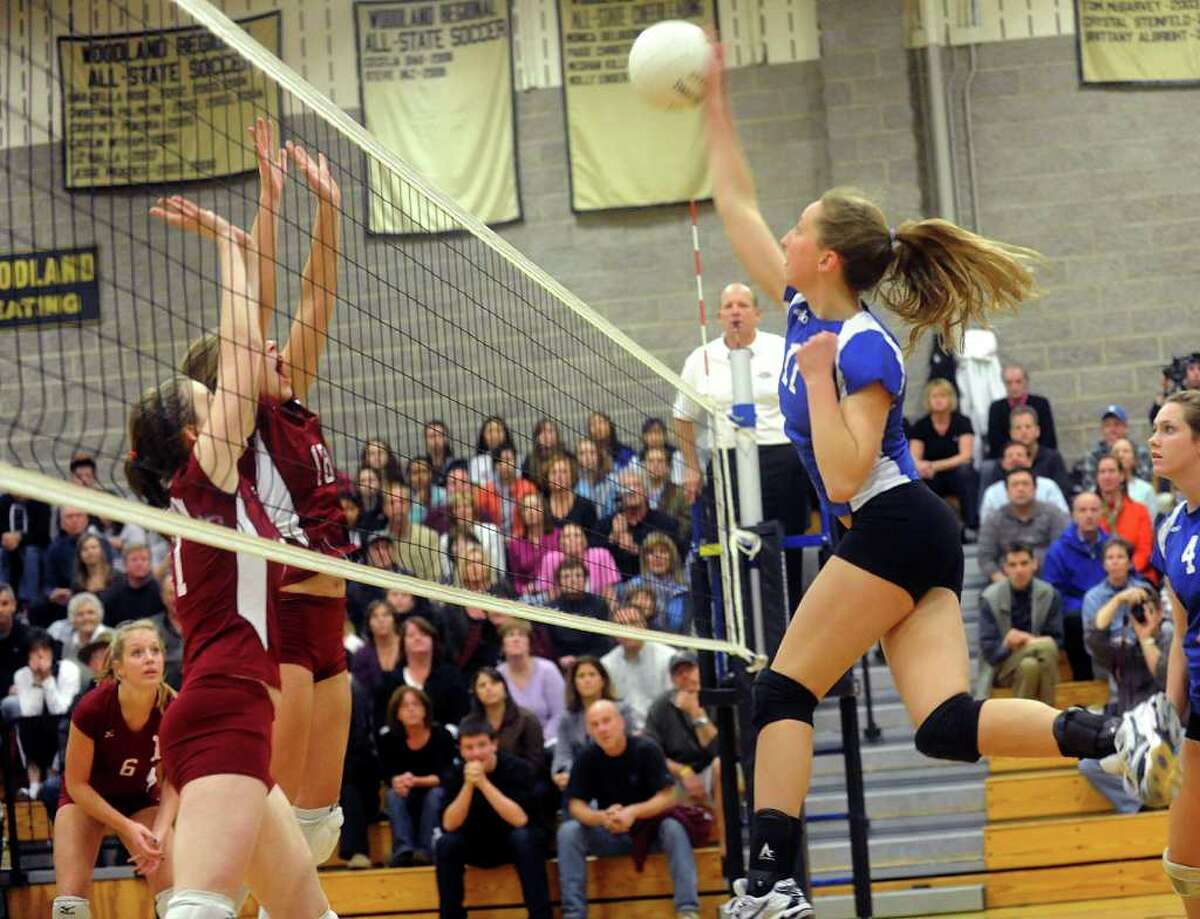 Darien's Katie Stueber spikes the ball during the Girls Volleyball State Tournament Class L Semifinal game against Farmington at Woodland High School on Thursday, November 18, 2010.