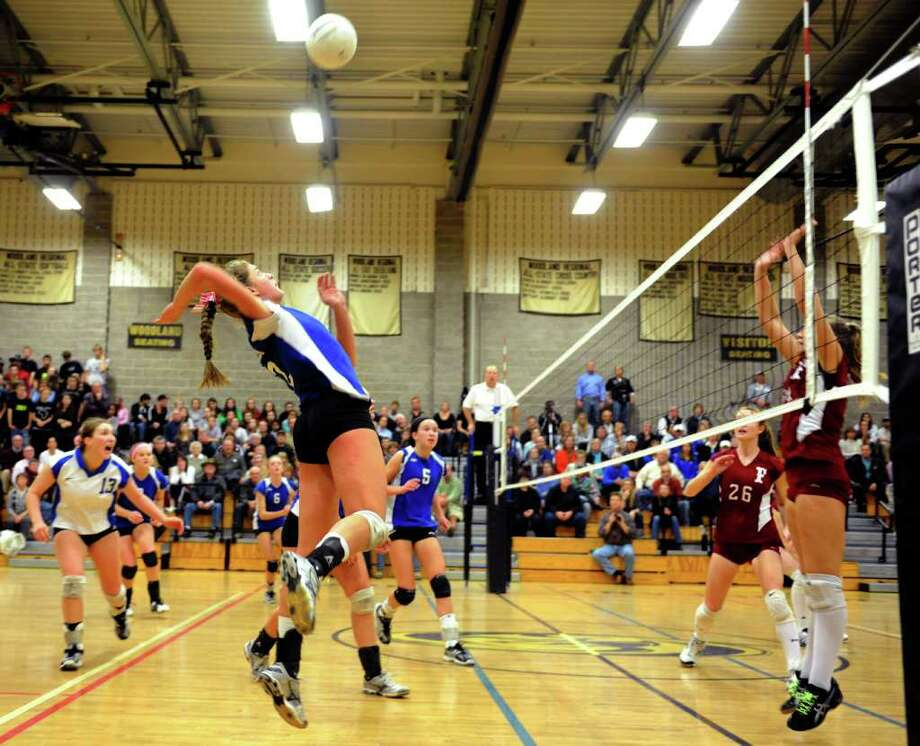 Emma Getsinger spikes the ball for Darien during the Girls Volleyball State Tournament Class L Semifinal game against Farmington at Woodland High School on Thursday, November 18, 2010. Photo: Lindsay Niegelberg / Connecticut Post