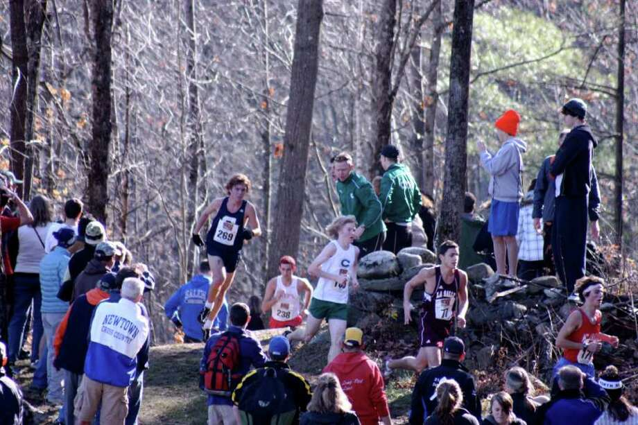 Staples senior captain Ben Aldrich pursues his opponents last Saturday in the New England Cross Country championship in Vermont. Aldrich placed 46th with a time of 17:44.6. Photo: Contributed Photo