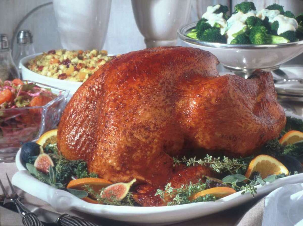 The price of 16-pound turkeys actually decreased by 99 cents to an average price of $17.66, or about $1.10 per pound. AP photo