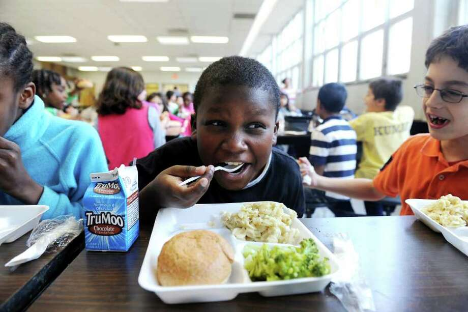 Kiefer Frager-Akins enjoys lunch with his fourth-grade class in the school cafeteria at Stark Elementary School in Stamford, Conn. on Thursday November 18, 2010 Photo: Kathleen O'Rourke / Stamford Advocate
