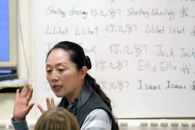 Mandarin Chinese language teacher Jing Tan during a class of the Chinese Language School of Connecticut at the Second Congregational Church, Greenwich, Thursday afternoon, Nov. 18, 2010. Photo: Bob Luckey / Greenwich Time