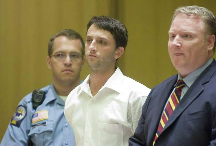 Spero Moschos, then 28, appears with attorney Stephan Seeger as he was arraigned in Superior Court in Stamford for two bank robberies in Stamford, Conn. on Thursday, August 27, 2009. Photo: File Photo / Stamford Advocate File Photo