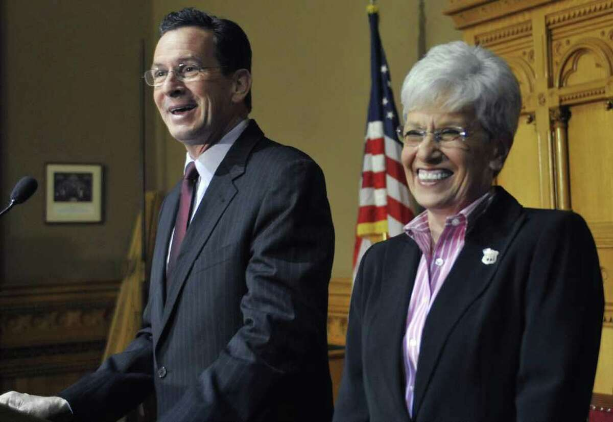 Dan Malloy, who won the Connecticut governor's race, speaks to the media with running mate Nancy Wyman at his side at the Capitol in Hartford, Conn., Monday, Nov. 8, 2010. (AP Photo/Jessica Hill)