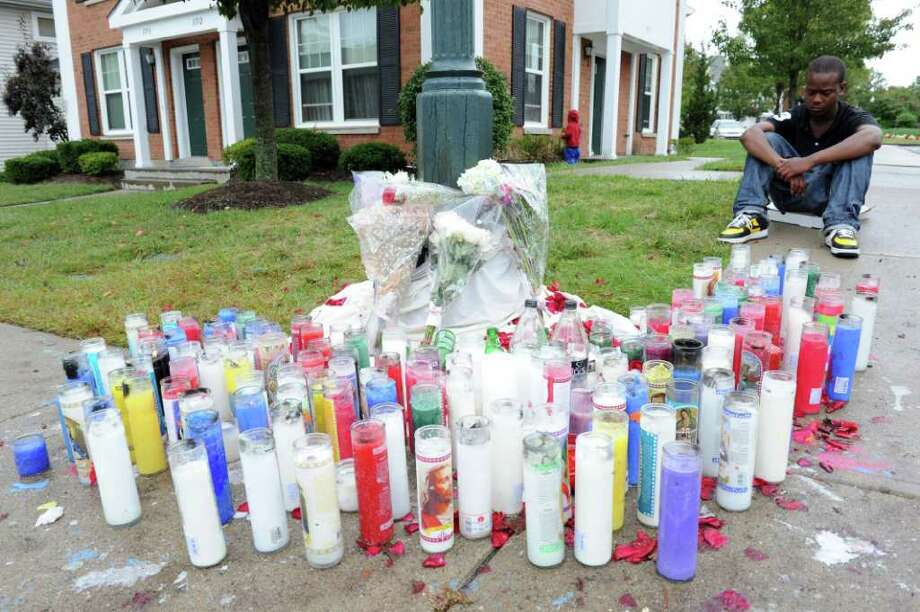 FILE — Tyshawn Malachi mourns shooting victim Donta Wilks on Southwood Drive where a shrine is set up in September. Photo: File Photo / Stamford Advocate File Photo