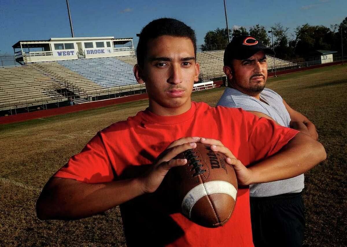 Supported largely by his father Bruce Reyes Sr., Bruce Reyes Jr. will throw for the Bruins in Baytown this Saturday in West Brook's match up against Pearland. Guiseppe Barranco/The Enterprise