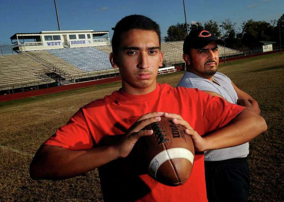 Supported largely by his father Bruce Reyes Sr., Bruce Reyes Jr. will throw for the Bruins in Baytown this Saturday in West Brook's match up against Pearland. Guiseppe Barranco/The Enterprise Photo: Guiseppe Barranco / Beaumont