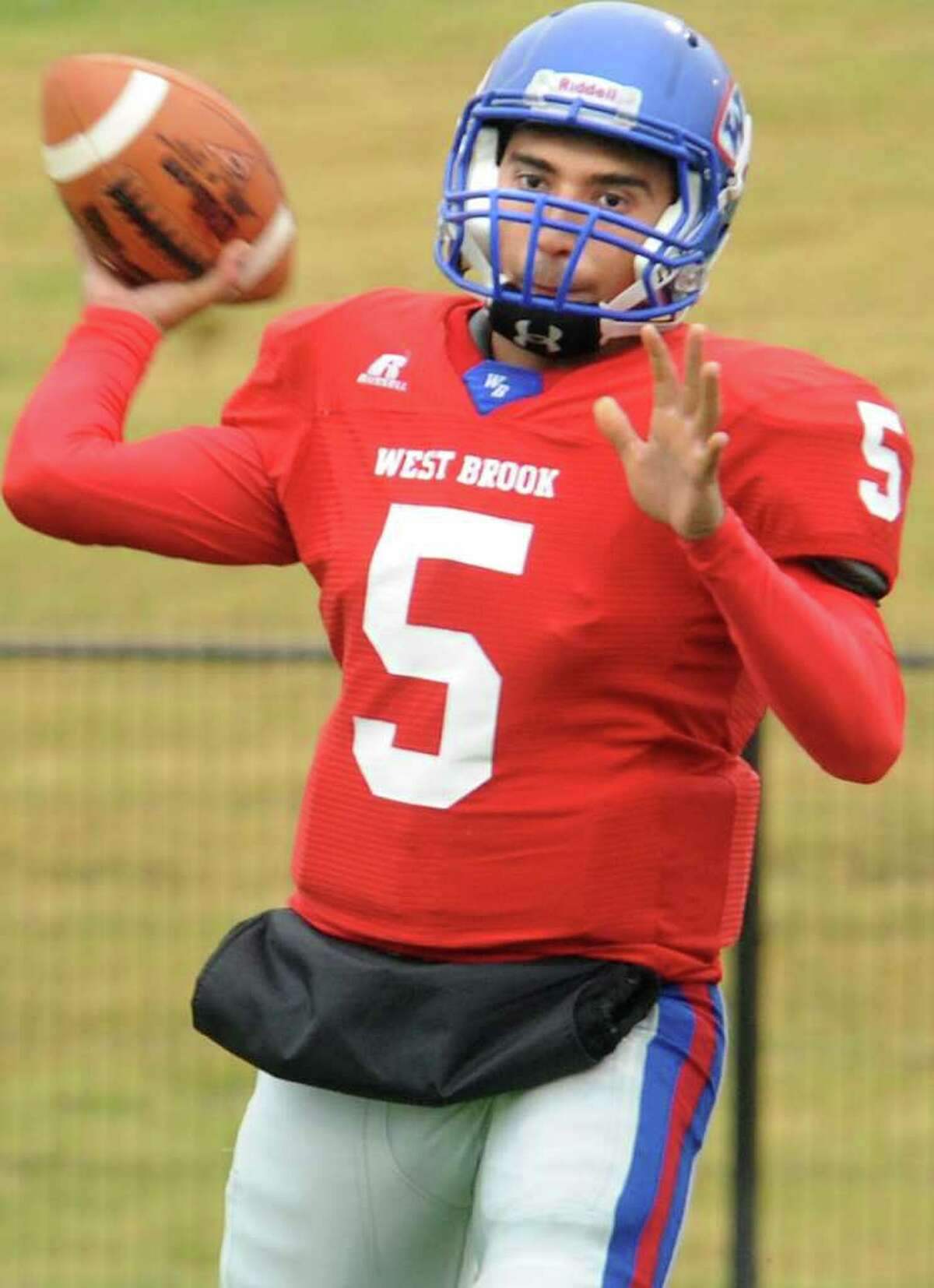 West Brook's Bruce Reyes looks to pass against Dobie during the first half of the play off game at the Carrol A.