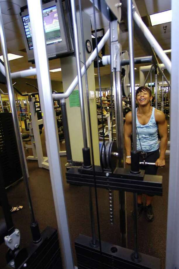 Pilara Martin, a bodybuilder, has been competing for a few years.  On Tuesday morning, she could be found working out at Beaumont Health and Fitness on Phelan Blvd.   Dave Ryan/The Enterprise Photo: Dave Ryan / Beaumont
