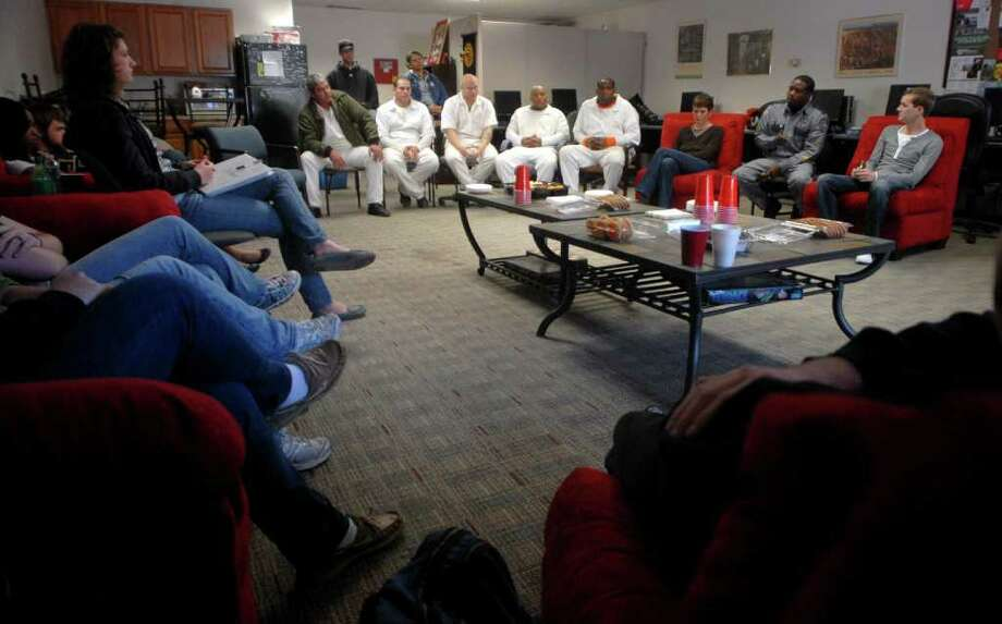 Inmates from the Gist Unit speak to students in the Victims, Criminals and Punishment honors seminar at Lamar University Thursday afternoon. The inmates - who have all reached trusty status, giving them additional privileges - spoke to the students about their work with Habitat for Humanity. The inmates work about 40 hours per week building homes for local families. Beth Rankin/The Enterprise
